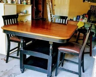 Bistro height table with 2 shelves. Includes 4 chairs and 2 stools.  It is 4'x4' but easily expands to 4'x6' with 2 hidden leaves.