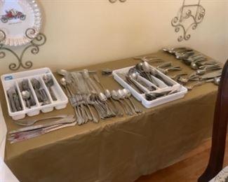Five sets of flatware