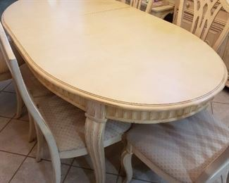 Table and 8 chairs with 2 leaves