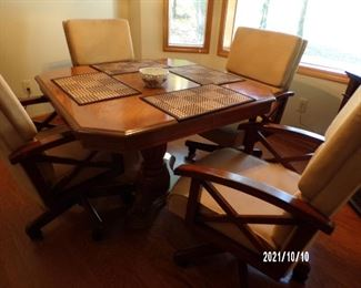 dining table w/4 chairs. on rollers