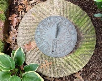 Come grow old with me, the best is yet to be. Sundial on ancient millstone