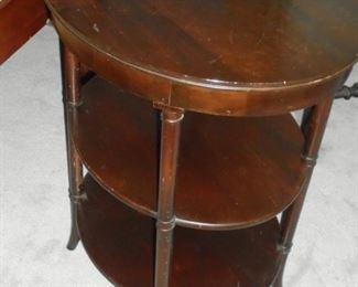 Mid century oval 3 tier mahogany able