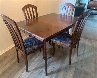 """Kitchen Table w/four chairs  48""""L x 34""""W additional leaf to expand table."""