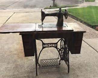 A Singer Sewing Machine!  The top (wooden part) of the sewing machine is rough and the machine needs a belt.