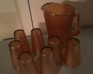 Vintage Peach Glass Pitcher Iridescent Pearlescent - 6 glasses come with it.