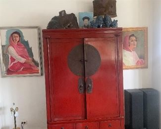 Vintage red lacquer cabinet. Two vintage portraits by Chicago artist Alfred Grimm.