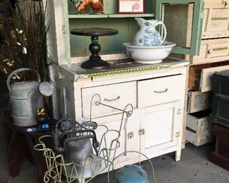 Farmhouse cupboards, green cart, fall harvest painted can, pitcher/bowl set.
