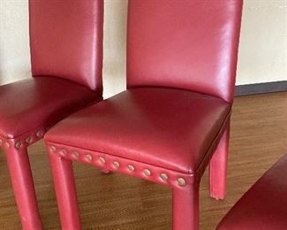 We have a great set of 5 red leather chairs