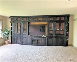 Beautiful classic dark wood wall media cabinet with bookshelves.