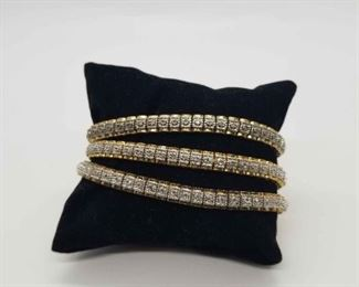 A Trio Of Gold Toned Sterling Bracelets