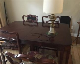 Dining room table, 2 leaves, pads and 4 chairs $200