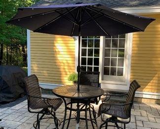Patio set with lighted umbrella