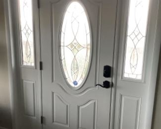 white fiberglass entry door with sidelights and beveled glass detail...