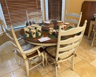 Beautiful Canadel dining table with 6 chairs and one leaf. Some of the Franciscan Apple dishes.