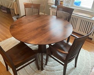 Dining table by Nichols and Stone, Mfg. 4 chairs, 2 leaves -- Provincetown pattern solid birch/maple