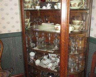 Antique oak china cabinet. China & stemware.