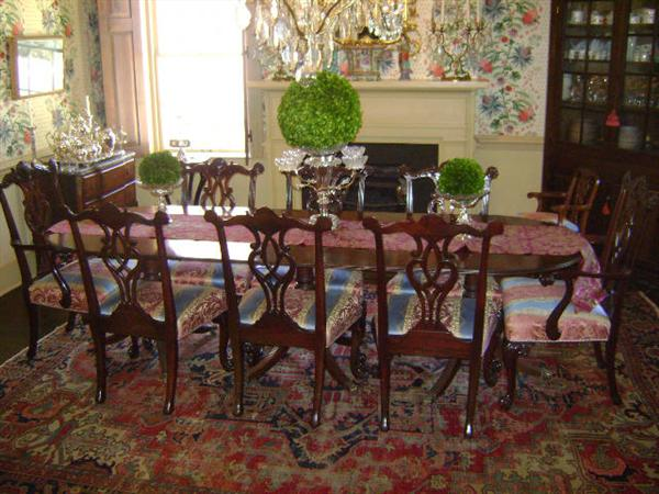 Sheraton dining room table with a set of Chinese Chippendale chairs in Clarence House fabric