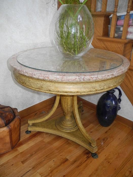 This is a beautiful marble topped table from the 1930's with claw feet, stunning!