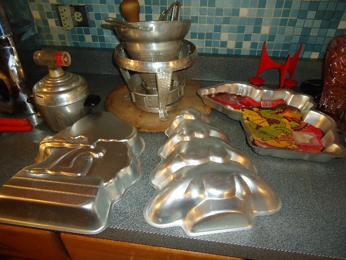 Quite a few Wilton pans plus cookie cutters and lots of baking items