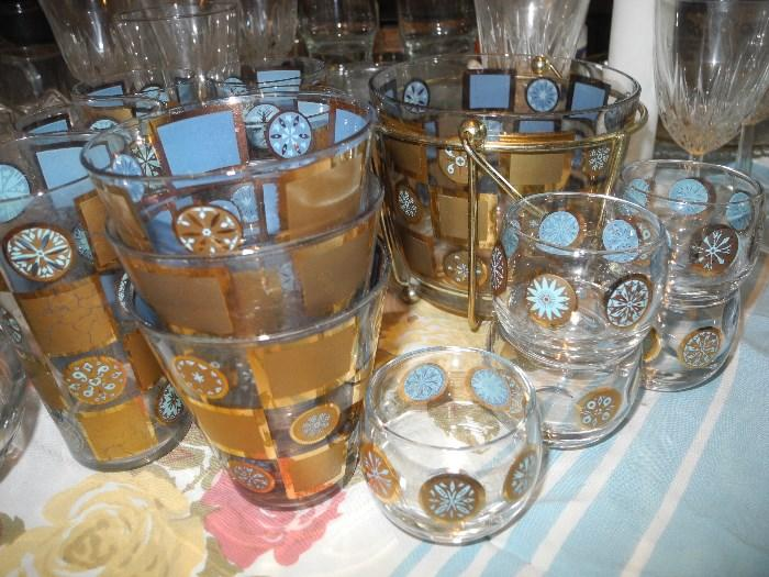 Very cool retro bar set....ice bucket, several sizes of matching glasses!