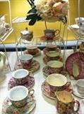 many cups & saucers