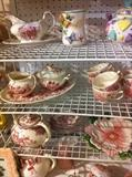 many teapots and other dishes