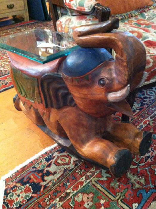 carved elephant end table/glass top