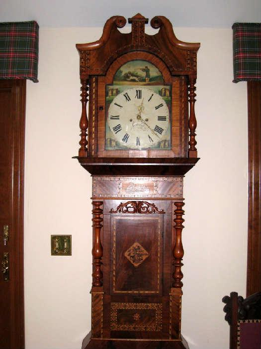 Of Scottish heritage from the 1790's -1800's.  Its matchstick mosaic.  Built of pine with mahogany veneer.  The outside of the door is crotch mahogany veneer.  The inside of the door is mahogany stain on pine.  The spindles on the bonnet on top are walnut.  The glass door frame has cross door banding.  The face is a hand painted rolled iron plaque.  The painting around it is oil.  The hands are the original brass and have been clean with acid.