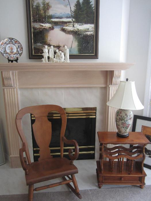 Do you know anyone who will be a grandparent soon or would just like a nice wooden rocker?   We have a very nice wooden rocker for sale. The oriental lamp on the magazine rack is precious.