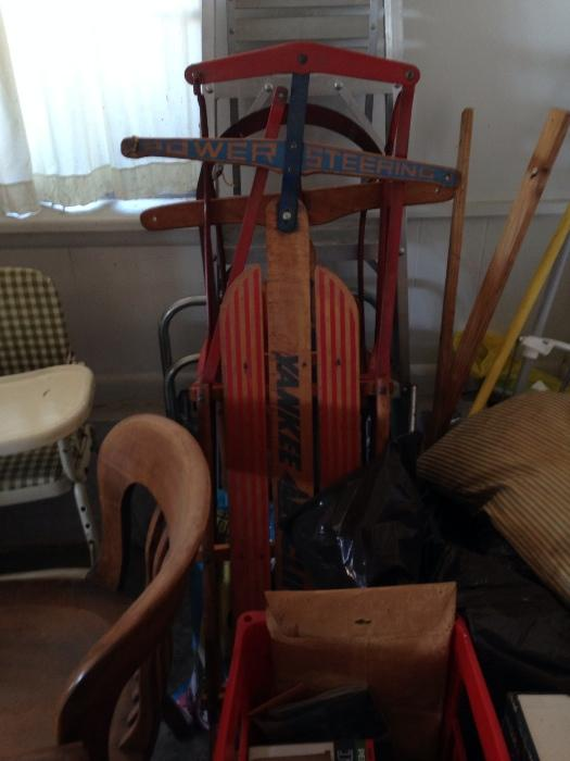 sleds and a vintage highchair