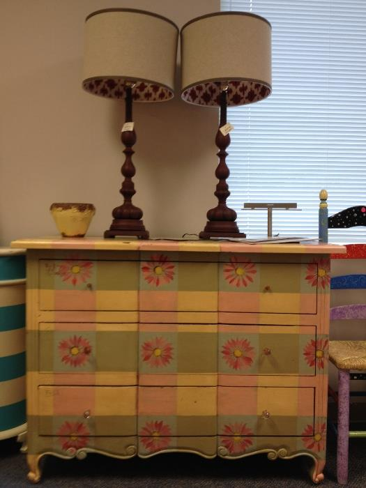 fun loving colors on this  painted chest  and a pair of neutral lamps, shades  lined in a rusty red and sand fabric