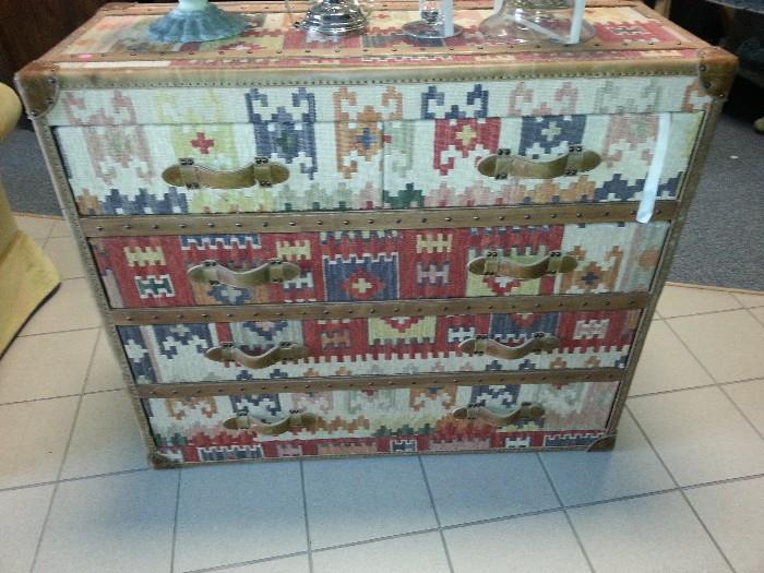 chest of drawers, meticulously covered  with a drury rug