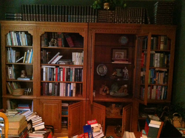 four section bookshelves one unit has leaded glass doors