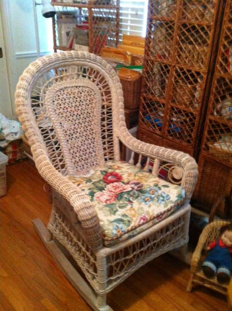 Probably Palacek wicker rocker, there is also a chld's wcker rocker, and several wicker tables and rattan shelves