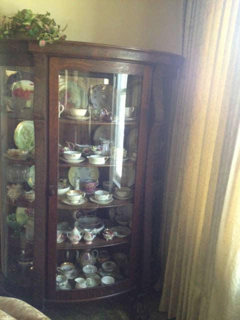 another view of the oak china cabinet with carved feet
