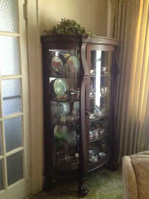 Beautiful bow front oak china cabinet with carved feet