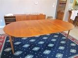 Danish Modern table,round with 2 large leaves.