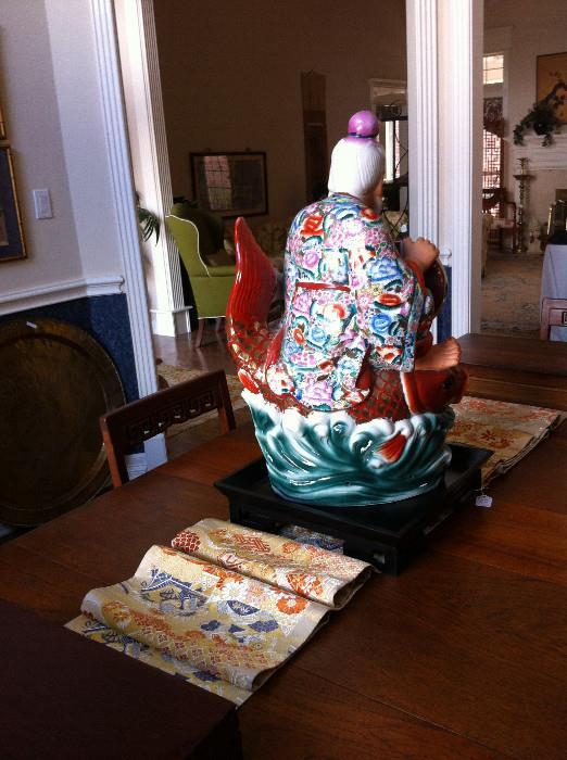 Back of Asian statue/ silk runner