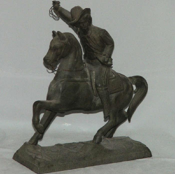 Old Metal Cowboy on Horse Sculpture