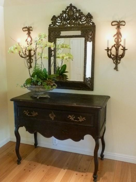 French Louis Philippe mirror, 1860s and ebonized provincial buffet.