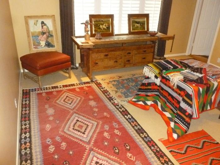 Native American, Mexican and Turkish Kilim weavings with early 20th century hand made work bench.