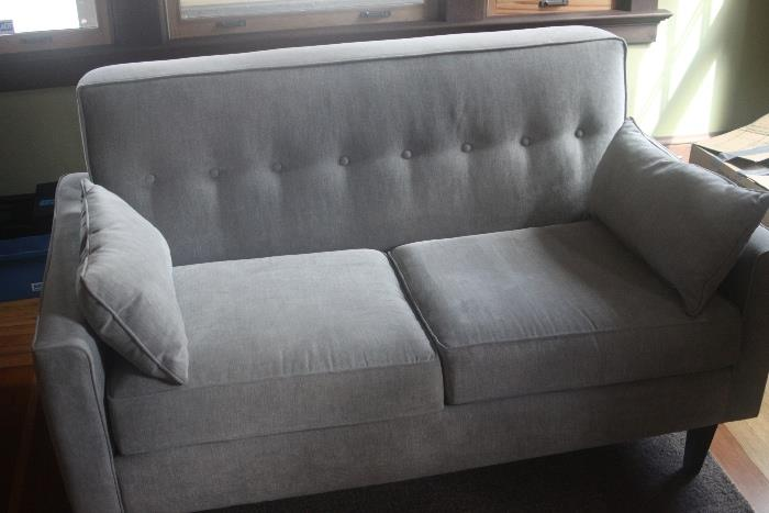 two identical grey loveseats