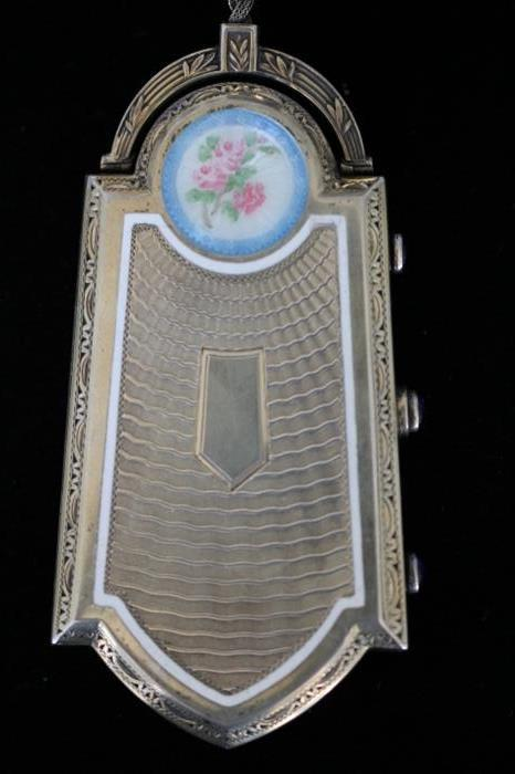 1920s Foster and Bailey sterling silver and enamel hinged compact with amethyst cabochon fasteners.