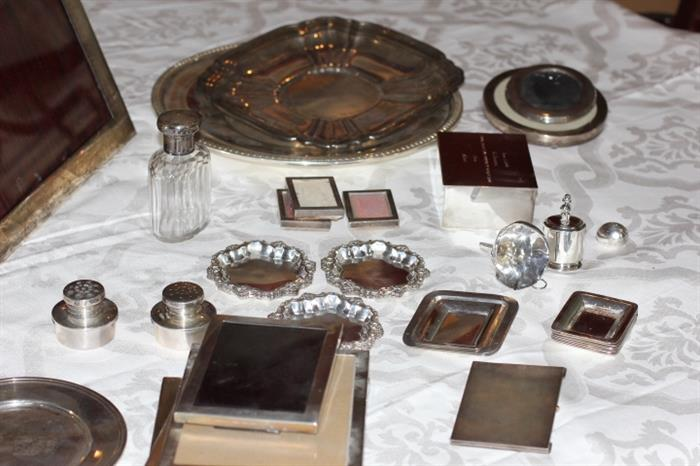 Nice assortment of sterling silver items, including sterling frames and other sterling smalls.    Two nice-sized sterling trays, too.