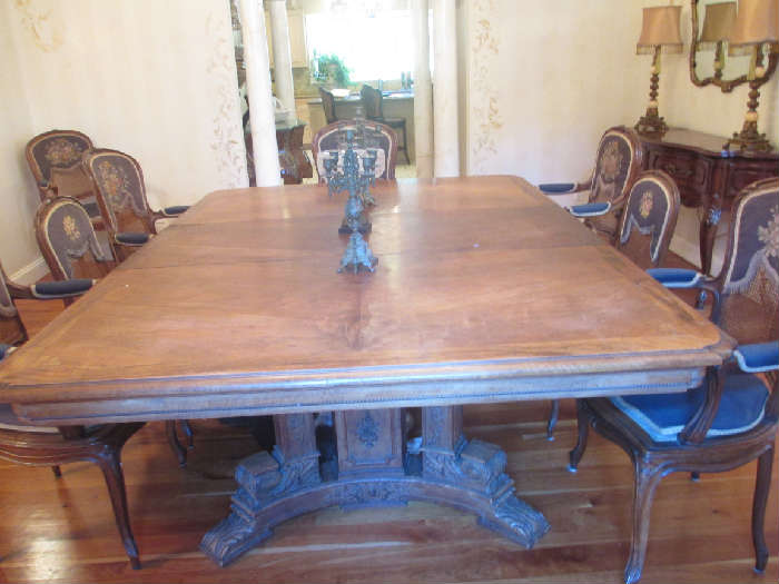ANTIQUE DINING ROOM TABLE WITH TWO LEAVES AND PADS AND 8 CHAIRS
