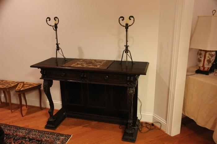 Pair of Arts and Crafts era forged lamps on pier table