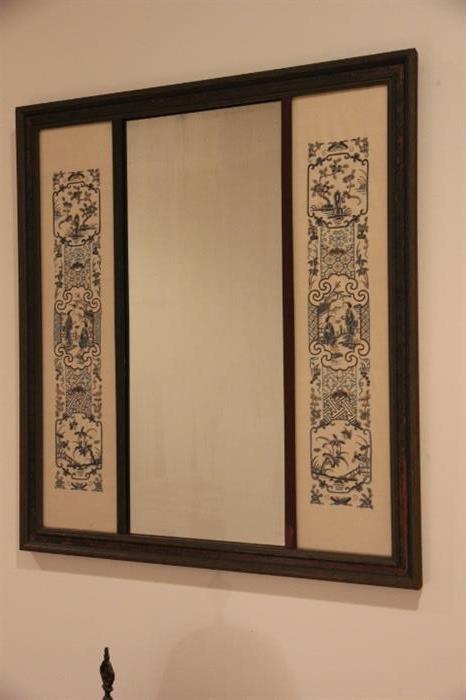 mirror in hallway....frame contains silk panels