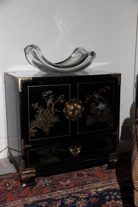 lucite bowl on Asian storage chest (one of a pair)