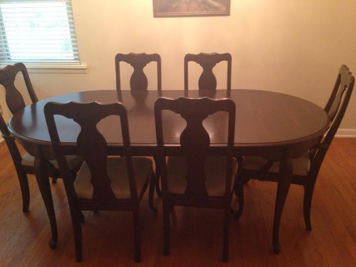 vintage ding table with two captain's chairs
