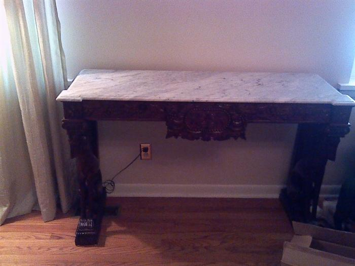Marble top credenza with carved dog legs